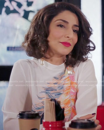 Delia's white feather print blouse on Girlfriends Guide to Divorce