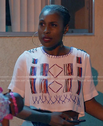 Issa's white embroidered crop top on Insecure