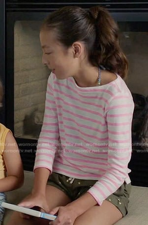 Lily's pink striped top and star print shorts on Modern Family