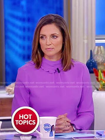 Paula's purple ruffle neck long sleeved top on The View