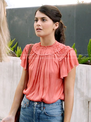 Sabrina's coral ruffled top on The Mick