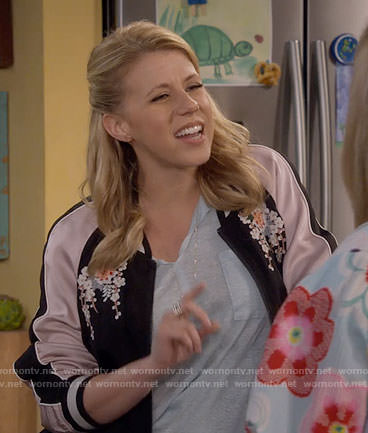 Stephanie's split-neck tee and embroidered bomber jacket on Fuller House