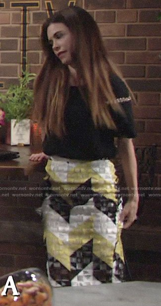 Victoria's black metal ring detail top and yellow geometric patterned skirt on The Young and the Restless
