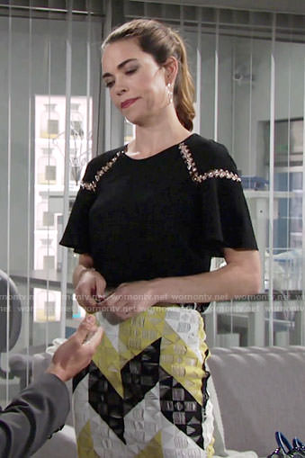 Victoria's black metal detail top and yellow patterned skirt on The Young and the Restless