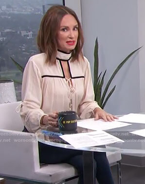 Catt's white contrast tie blouse on E! News Daily Pop