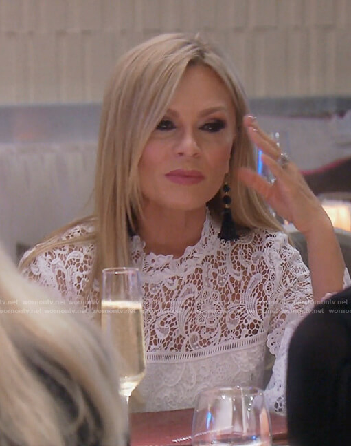 Tamra's white lace bell sleeved top on The Real Housewives of OC