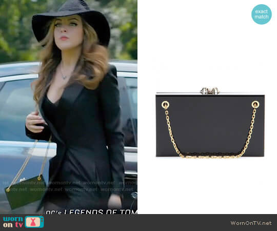 Charlotte Olympia Dora Box Clutch in Black worn by Elizabeth Gillies on Dynasty