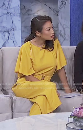 Jeannie's yellow jumpsuit with belt on The Real