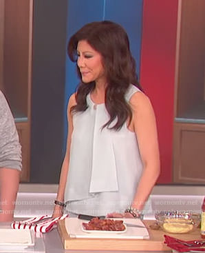 Julie's blue ruffle sleeveless top on The Talk