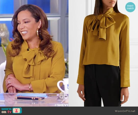Dawn pussy-bow satin-crepe blouse by Khaite worn by Sunny Hostin  on The View