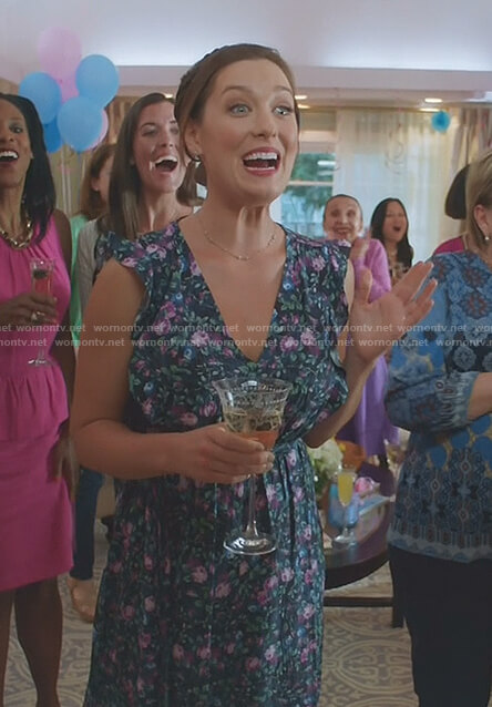 Katie's navy floral v-neck dress on Great News