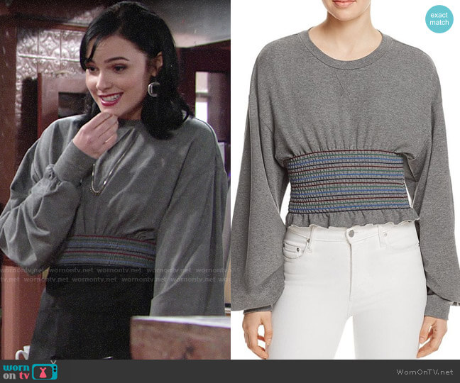 Petersyn Cory Smocked Sweatshirt worn by Tessa Porter (Cait Fairbanks) on The Young & the Restless