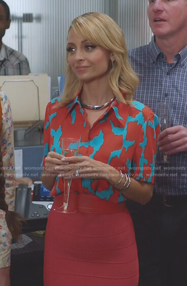 Portia's orange and blue printed shirt and orange bandage skirt on Great News