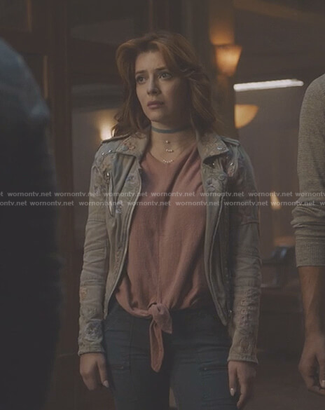 Sonia's pink tie front top and floral embroidered moto jacket on The Gifted