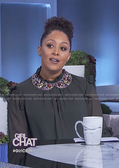 Tamera's black ruffle mock neck top and beaded collar necklace on The Real