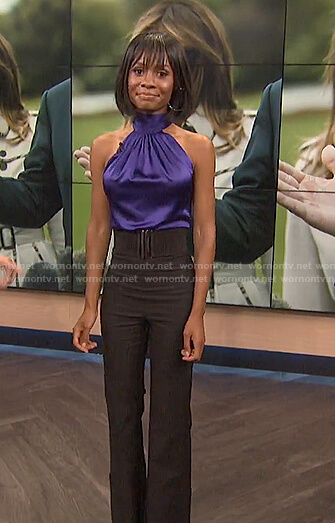 Zuri's blue halter sleeveless top and black pants on E! News