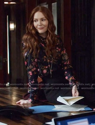 Abby's black floral blouse on Scandal