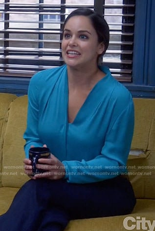 Amy's blue v-neck blouse on Brooklyn Nine-Nine