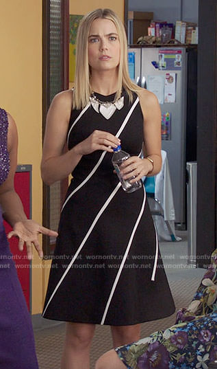 Anna's black dress with white diagonal stripes on The Mindy Project