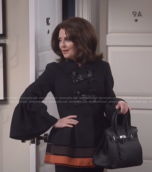 Karen's black buckle front bell sleeve jacket on Will and Grace