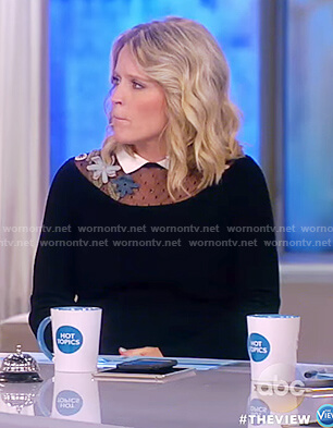Sara's black embroidered neck line knit dress on The View