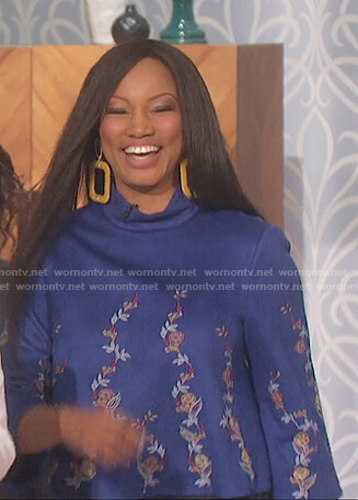 Garcelle Beauvais's blue embroidered floral top on The Talk