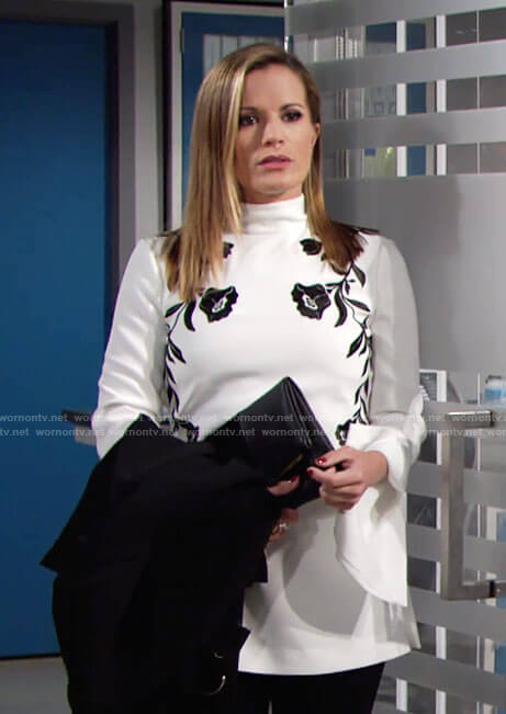 Chelsea's white top with black floral embroidery on The Young and the Restless