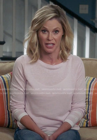 Claire's pink sweater with striped trim on Modern Family