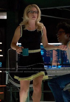 Felicity's black dress with yellow stitched trim on Arrow
