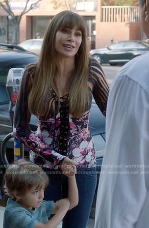 Gloria's floral lace-up top on Modern Family