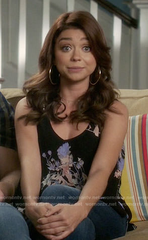 Haley's black floral top on Modern Family