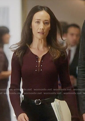 Hannah's burgundy barbell top on Designated Survivor