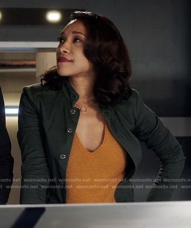 Iris's orange knit top on The Flash