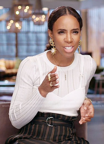 Kelly Rowland's white pointelle top and striped trousers on The Voice