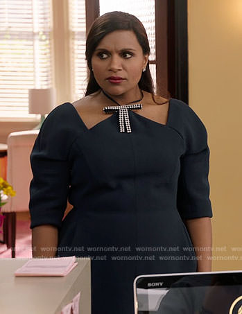 Mindy's black cutout top with diamante bow and red skirt on The Mindy Project