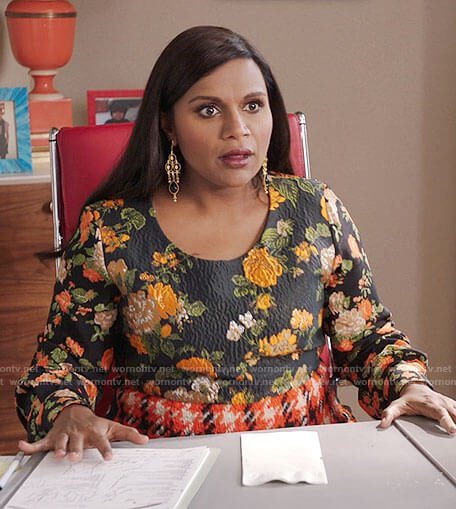 Mindy's black floral top and orange houndstooth skirt on The Mindy Project