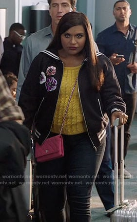 Mindy's yellow cable knit top with hearts and bomber jacket on The Mindy Project