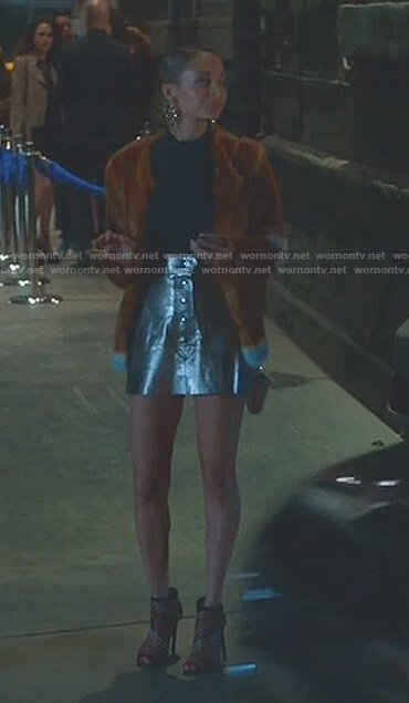 Portia's brown fur coat and metallic mini skirt on Great News