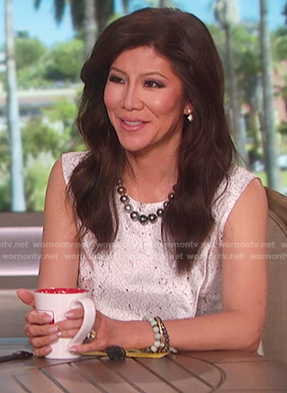 Julie's white sleeveless printed top on The Talk