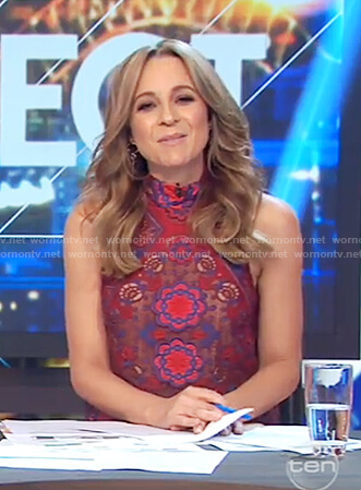 Carrie's red embroidered floral lace top on The Project