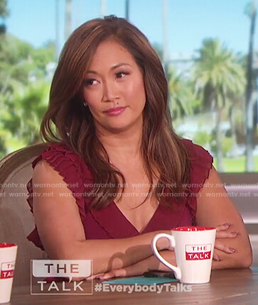 Carrie Inaba's red ruffle wrap dress on The Talk