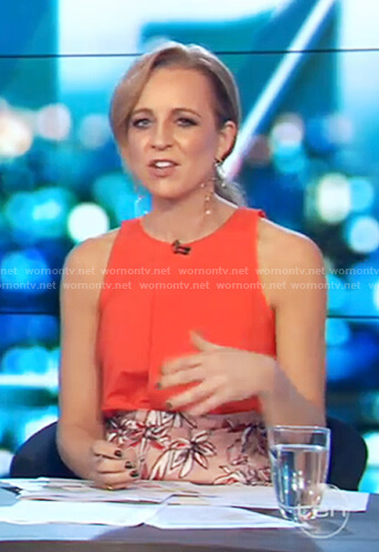Carrie's red top and floral printed skirt on The Project