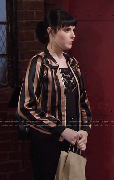 Tessa's bronze striped bomber jacket on The Young and the Restless