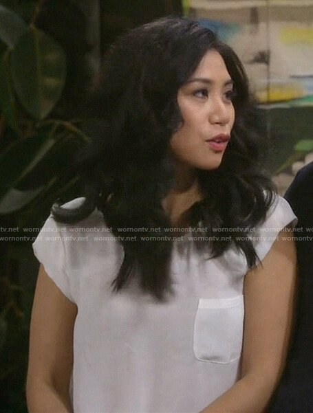 Eve's white front pocket short sleeve top on 9JKL