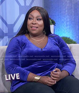 Loni's blue velvet peplum top on The Real