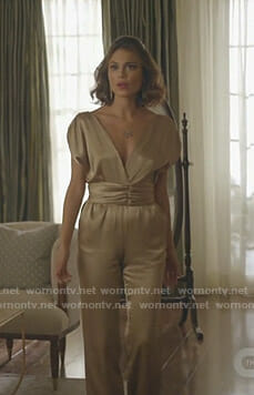 Cristal's gold v-neck jumpsuit on Dynasty