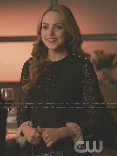 Fallon's black lace dress with ruffle cuffs on Dynasty