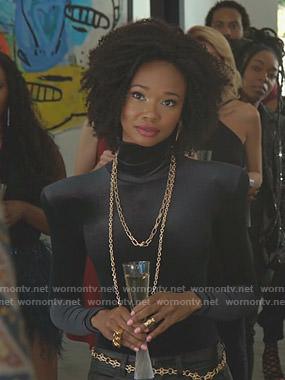 Monica's black velvet turtleneck top on Dynasty