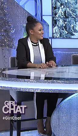 Tamera's silver knit top and side striped pants on The Real