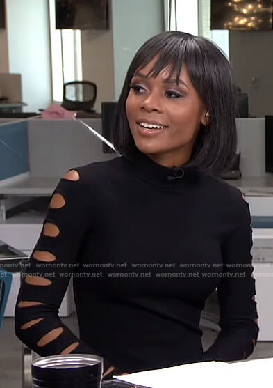 Zuri's black cutout sleeve top on Live from E!